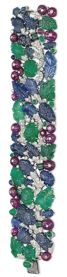 AN ART DECO DIAMOND AND MULTI-GEM 'TUTTI-FRUTTI' BRACELET, BY CARTIER