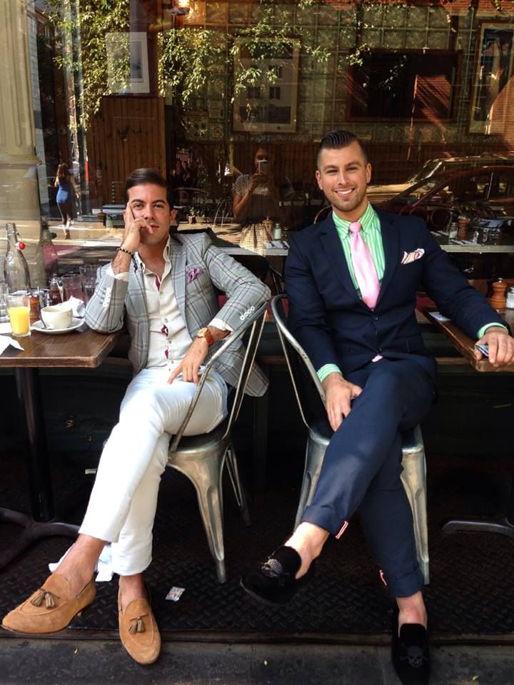 Luis Ortiz, attired in warm-weather colors, enjoying a sidewalk cafe, sans socks