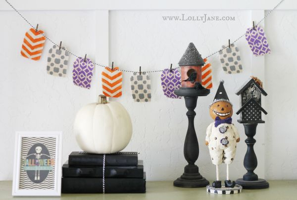 tutorial for stenciled Halloween bunting / love this whole vignette - framed skeleton print is free on eighteen25 blog