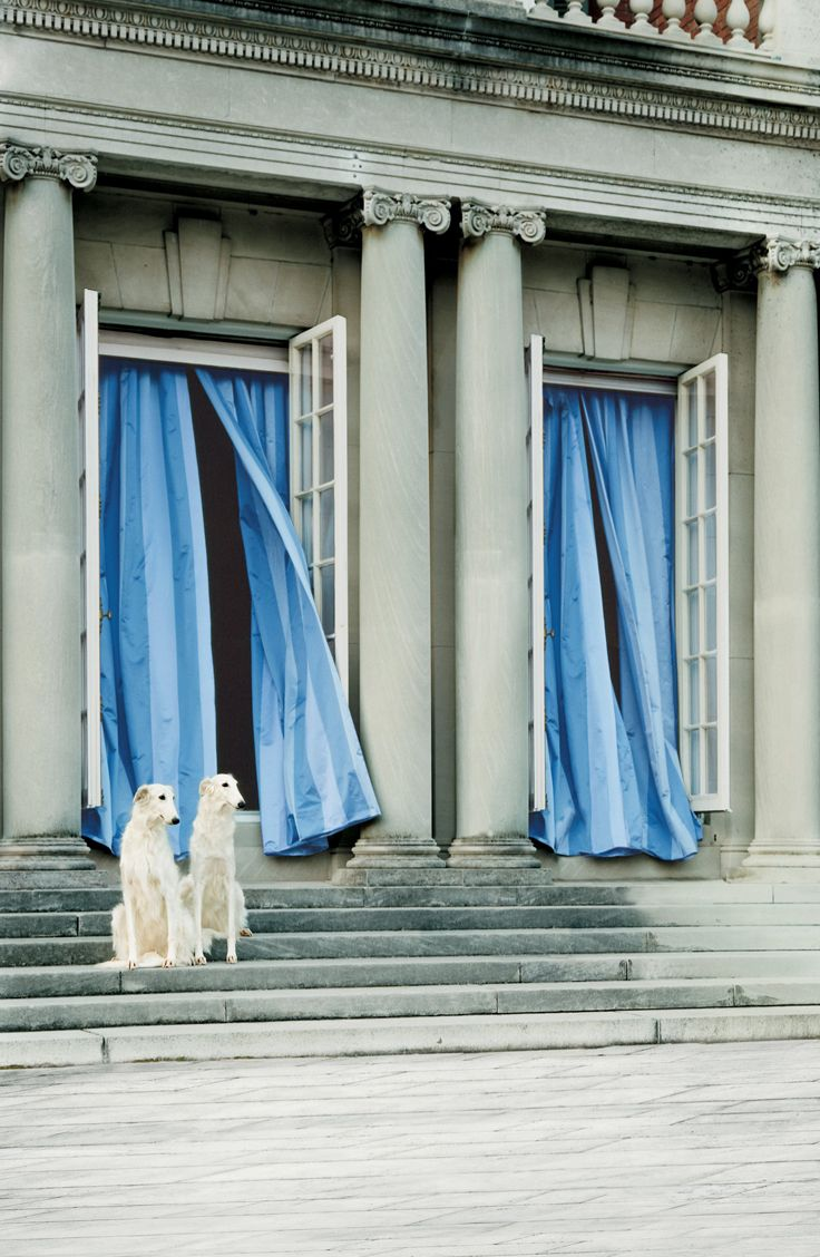 Take in the breeze. Ralph Lauren Home blue, tonal striped fabric as elegant curtains.