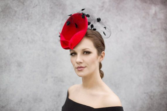 Ellie is a stunning saucer hat made from rich velour felt and finished with exquisite rare spot vintage veiling, perfect hat for the races. The