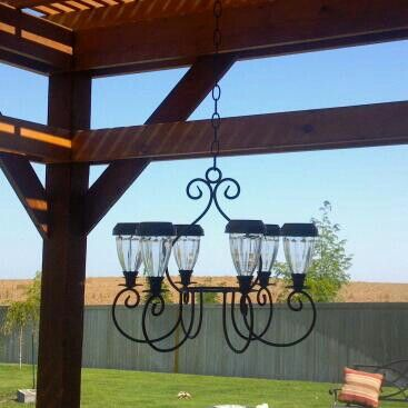 Made my own outdoor chandelier for the pergola with solar lawn lights!