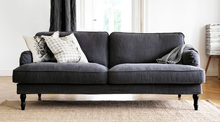 2-seat grey sofa in brightly lit room. Love the lines of this sofa.