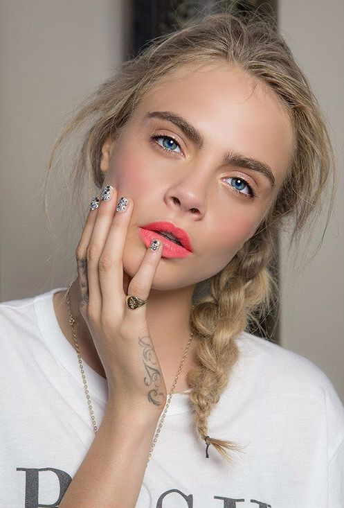 cara delevingne braid, pink lips, and glittery nails