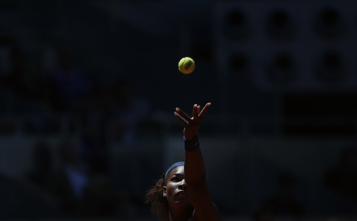 Serena Williams of the U.S. serves the ball to Maria Sharapova of Russia during their womens singles final match at the Madrid Open tennis tournament. (Susana Vera/REUTERS)