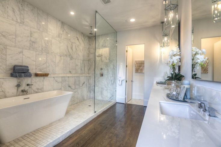 jacuzzi tub shower combo towels faucets cool lamps hardwood floor ceiling lights flowers transitional bathroom of Astoundingly Cool Jacuzzi Tub Shower Combo to be Mesmerized By