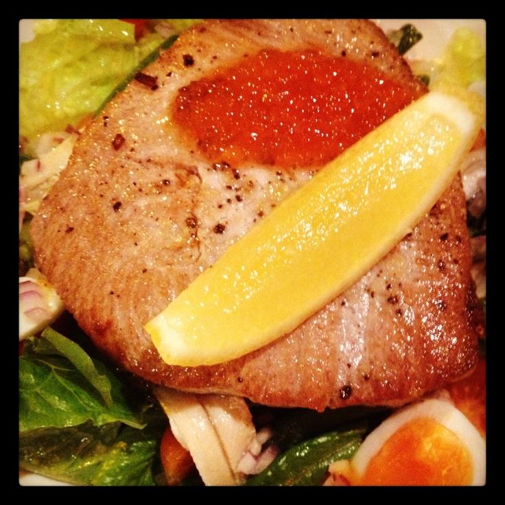 Rare tuna fillet on nicoise salad
