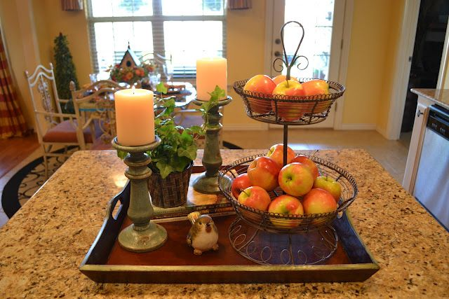 Another idea from Melissa's blog ~ love the fresh ivy and real apples, along with some old cookbooks.