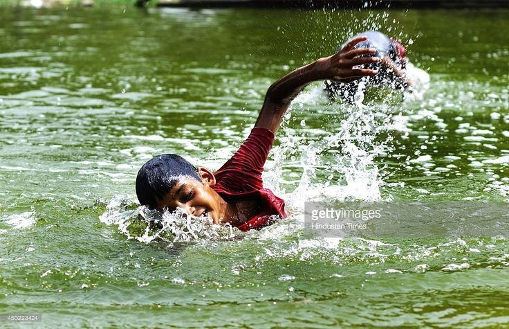 A child cooling off in the pond during the hot afternoon on June 7, 2014 in New Delhi, India. North Indians are expected to bear the scorching heat for a few more days as the temperature has gone up by 46 degrees, as per Meteorological Department. Heat wave conditions intensified today in most parts of the country with temperatures hovering around 47 degrees Celsius, affecting normal life. No respite is due in the coming days though the monsoon hit Kerala, a day behind schedule. Amritsar and…