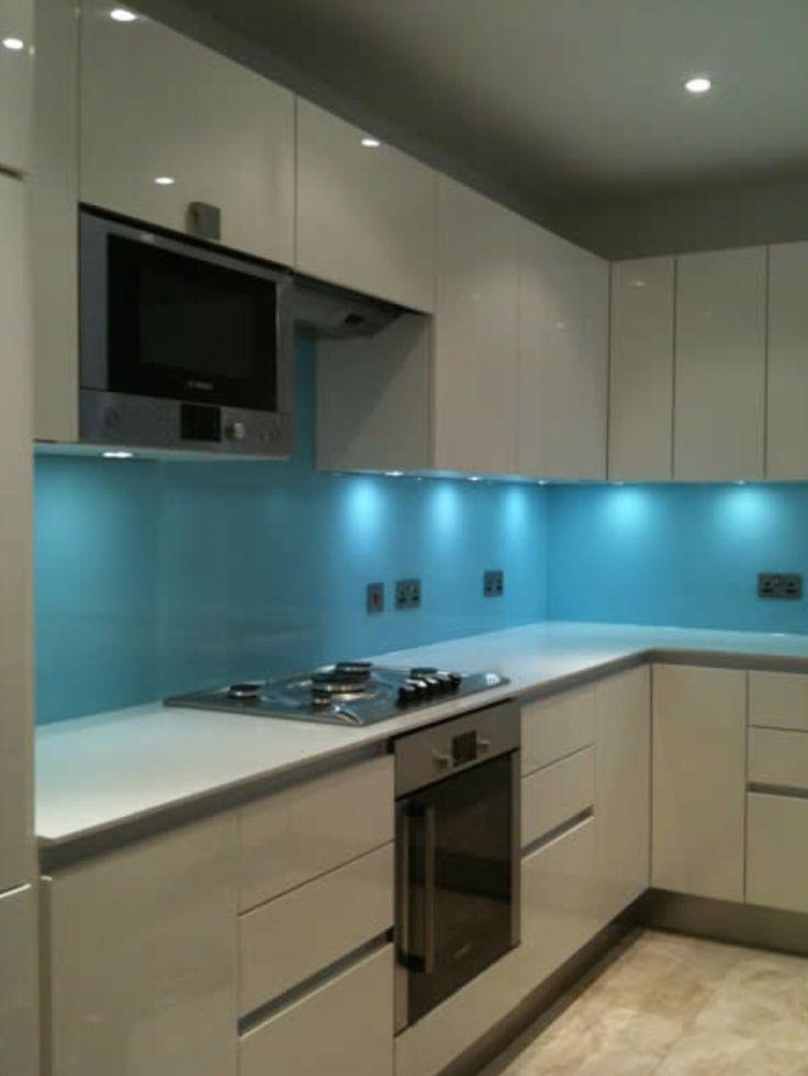 New gloss kitchen with glass splashback