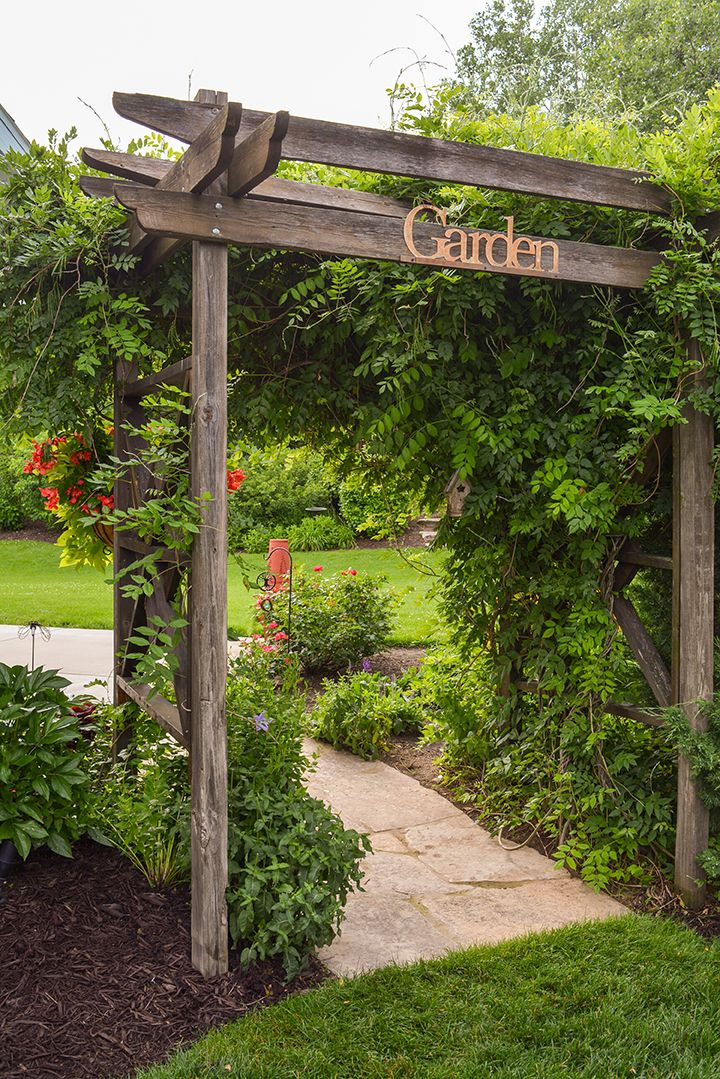 Popular garden entryway tips and ideas. Rustic, cottage garden ideas. Easy wooden pergola ideas and tips. Garden entryway ideas. Rustic garden signs. Vines for pergolas, vines for entryways and mailboxes. garden pathways ideas, mckay nursery blog ideas and advice.