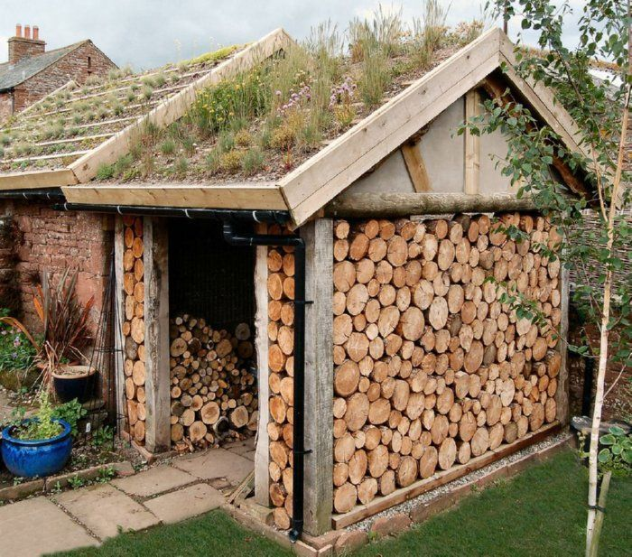 stacked wood walls / wood shed / living roof