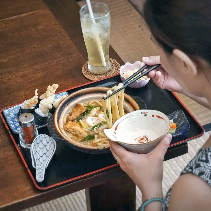 #Bali. It's so cloudy today.. Just a perfect time for a big bowl of Hot Nabe Yaki Udon with its flavorful broth  this one is my favorite bento from @IchiiJapanese Restaurant. Complete with tempura rice balls and potato salad.