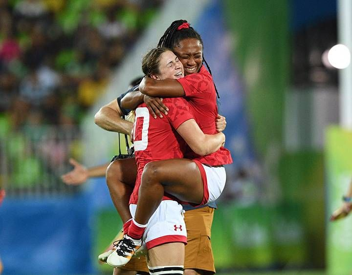Canada's Charity Williams, right, jumps into the arms of Hannah Darling as they win bronze defeating Great Britain's in women's rugby sevens at the 2016 Olympic Summer Games in Rio de Janeiro, Brazil on Monday, Aug. 8, 2016.