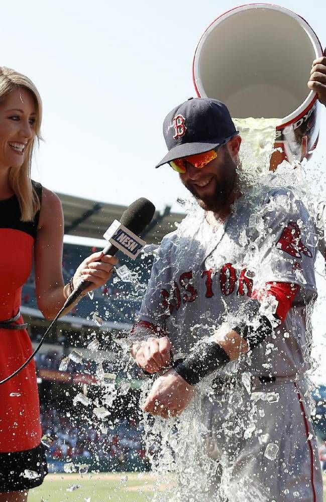 Dustin Pedroia, is doused by first baseman Hanley Ramirez,July 31, 2016, in Anaheim, Calif. (AP Photo/Ryan Kang)