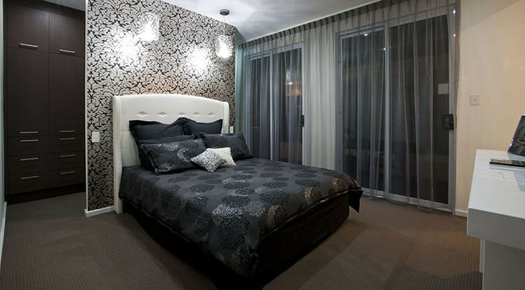 The stunning master bedroom has a glamourous air. #bedroom #weeksbuilding