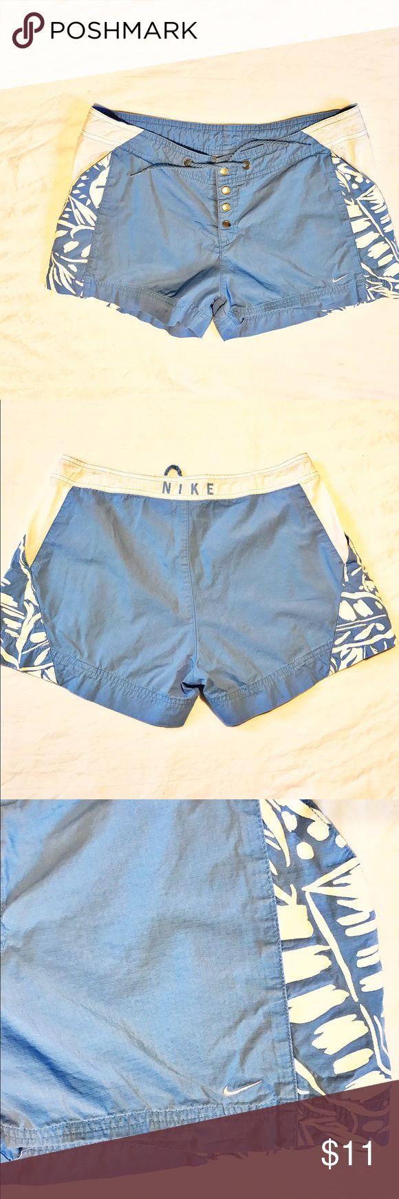 Euc! Nike swim shorts. Size small 4/6 Euc! Nike swim shorts. Size small 4/6. Blue and white with pockets. 4 snap closure with tie waist. Nike Swim