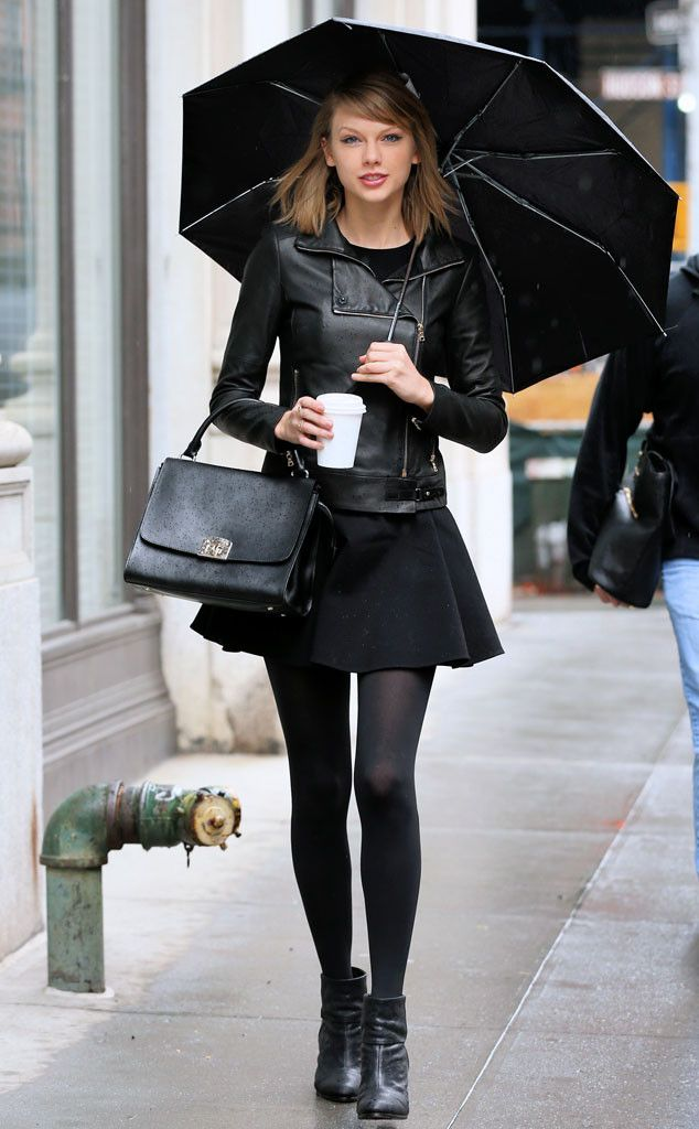 Cloudy Skies from Taylor Swift's Street Style Taylor makes rainy day dressing look so stylish in this black leather jacket, mini skirt and tights.