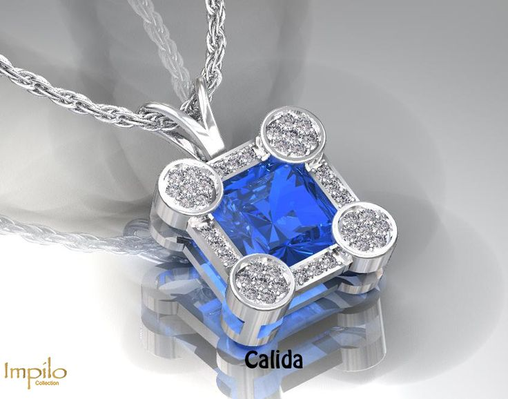 """""""Calida"""" - Contemporary and unique design with a beautiful blue topaz centre stone and round brilliant cut diamonds on each corner, surrounded by smaller diamonds and finished off with a rabbit ear bail."""