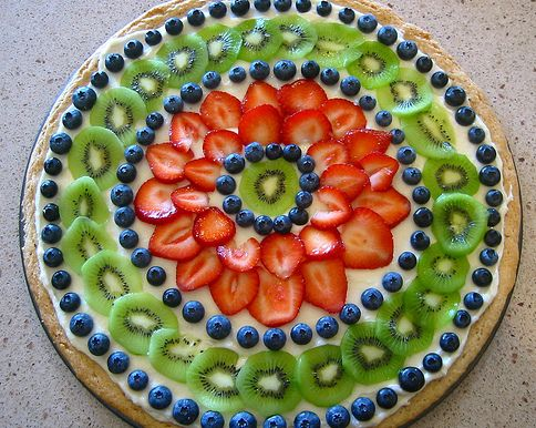 Fruit pizza - refrigerated sugar cookie dough rolled out to size of pizza pan & cook per instructions, spread cream cheese (2 (8-ounce) packages cream cheese layer, 2/3 cup sugar &  1/2 teaspoon vanilla extract or other flavoring (almond, orange, or lemon).  Add fruit you like!