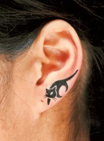 Kitty on ear loop tattoo. Every cat tattoo reminds me of you @Dianne Benedict