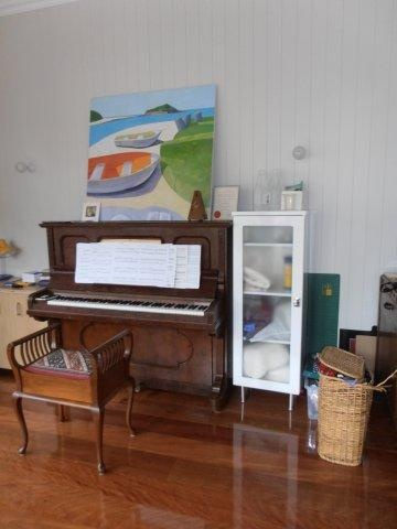 Piano room.    Complete Queenslander home renovation. 3.3m high ceilings, V.J. boards & polished timber floors.  Brisbane  www.empiredesigns.com.au