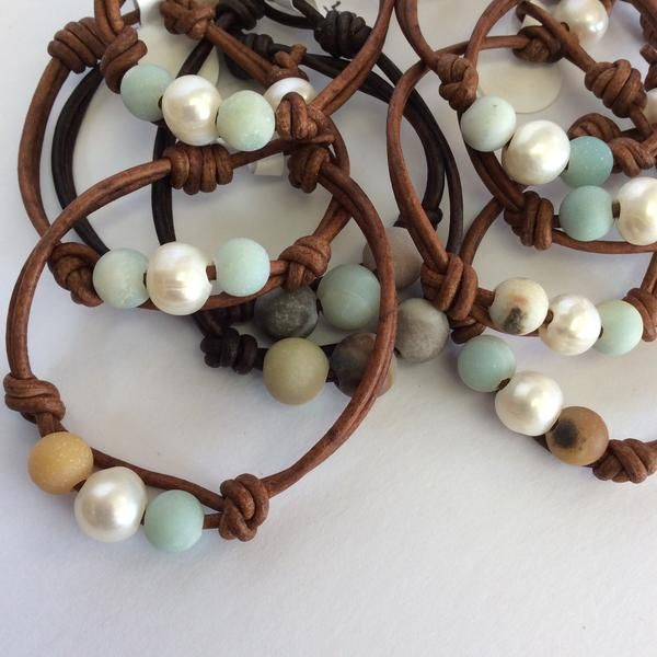 Two Amazonite stones surrounding a freshwater pearl on your choice of leather.
