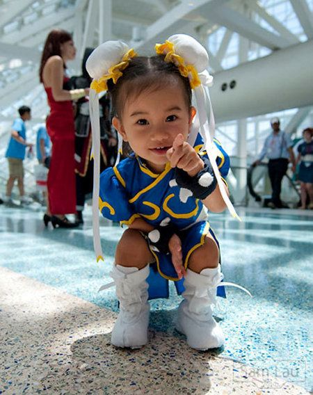 I would hug this little girl all day, she is adorable. Oh to make it more awesome get an itty bitty Ryu.  Real life pocket fighter.