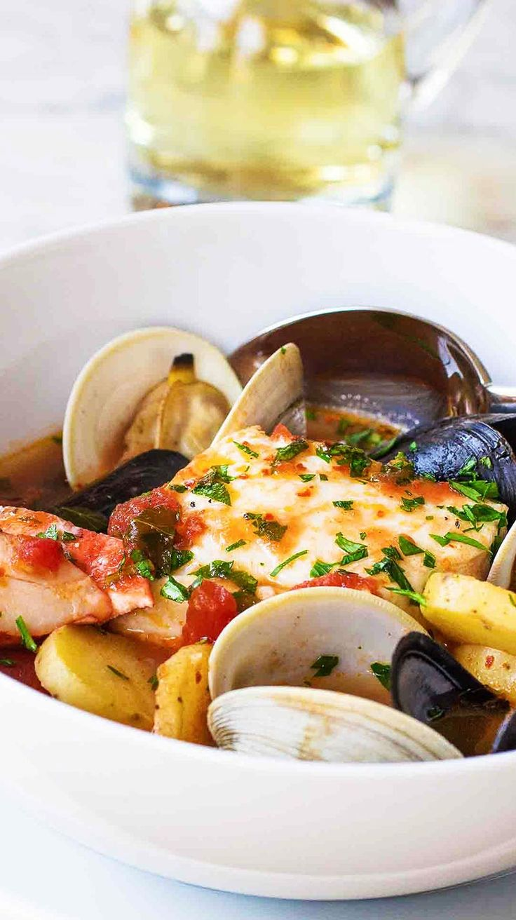 New England Cioppino seafood stew with haddock, lobster, clams, and mussels. Perfect for a casual dinner party!