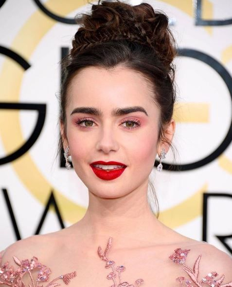 Our Ambassadress, @LilyJCollins looked ravishing on the #goldenglobes red carpet. Makeup Artist, @FionaStiles used L'Absolu Rouge Lipstick in Souvenir with a touch of loose powder to create Lily's incredible matte red lip. #LancomeRedCarpet