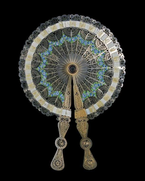 A popular accessory for women in the 19th century was a cockade fan