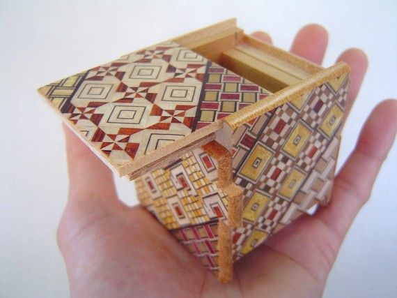 I think it would be different and unexpected to give a puzzle box as a gift, watch as they try to open it and eventually find an engagement ring inside! <3