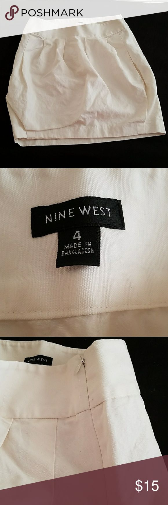 Nine West Ivory Skirt Beautiful size 4 Ivory Skirt. Nine West. Excellent condition. Just too short for me. Side zip. Has a lining. Linen and Cotton mix. About 18 inches in length. Great for work or play. 14 inches at top. 16.5 inches at waist. Nine West Skirts