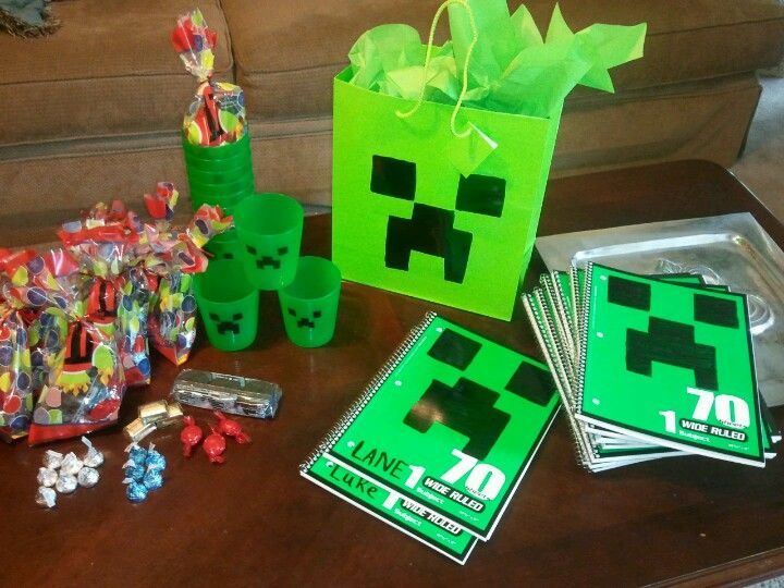 Lane's Mindcraft Party . Notebooks .17cent each. Used black permanent marker.Plastic cups found at Target $1.76 for six.Black paint pin. Candy for stones and metal .