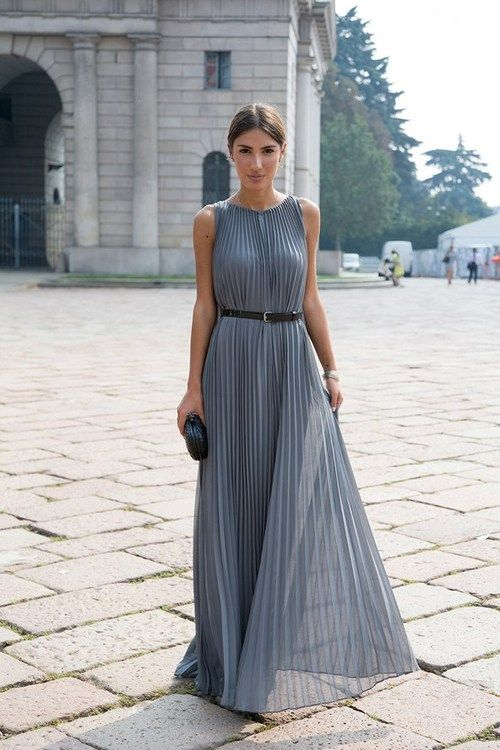 Patricia Manfeld, blogger wearing a Halston dress and Bottega Veneta clutch (image: vogue)