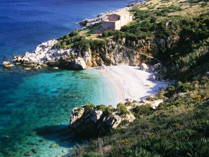 CALA MARINELLA Sicily Sicily dominates any list of beautiful Italian beaches and it's not hard to see why. Cala Marinella is yet another secluded white sand cove nestled into low cliffs, in a peaceful nature preserve in the Gulf of Castellammare.