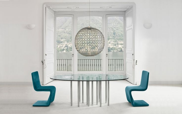 Bonaldo Mille table  This table seems to have all the harmony and dynamism of a transparent body in motion. Mille is a fixed table with a transparent glass table top, available in different shapes and sizes. The chromed steel legs, available in variable quantities depending on the size of the table top, provide maximum stability and visual consistency.  http://www.industryinterior.com/en/prod/living-room/table/bonaldo-mille-table.html