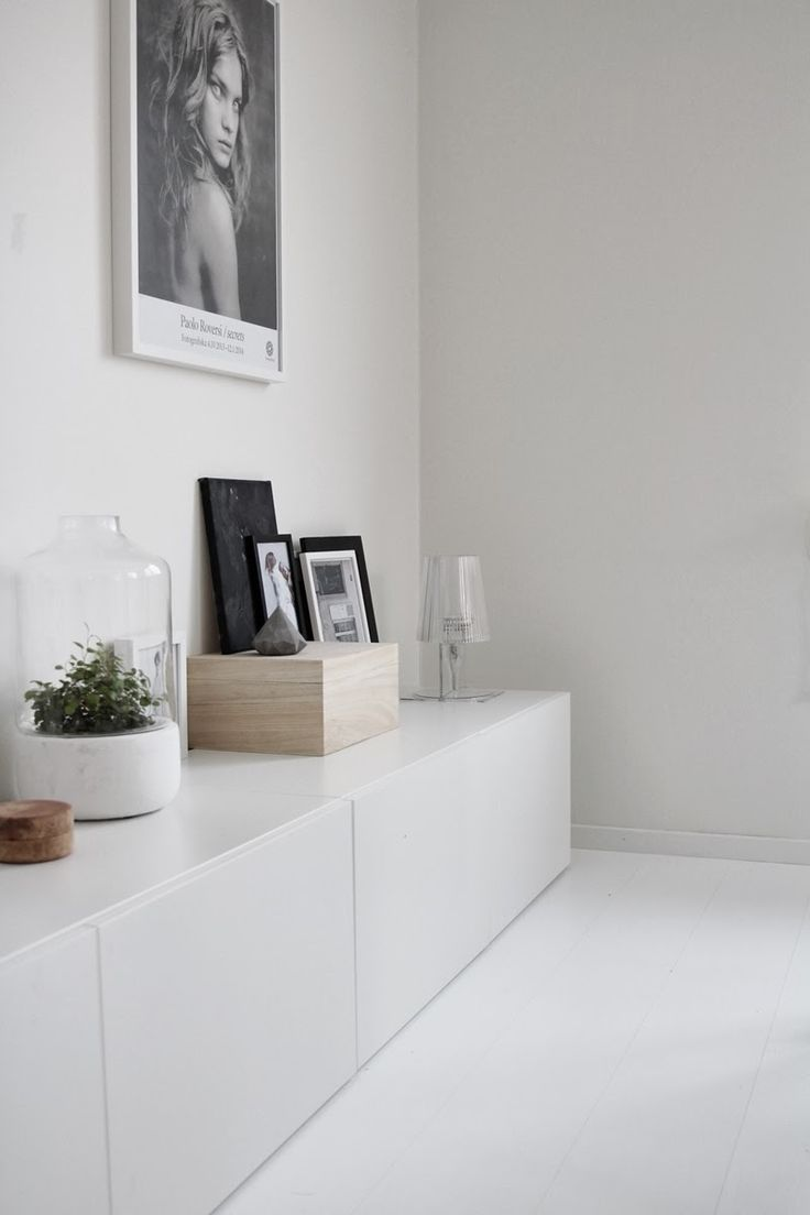 white wooden floors + white walls + white sideboard