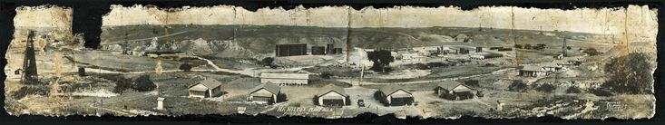 September 3, 1928. H. F. Wilcox Oil & Gas Company, Pampa, Texas, Plant No. 5. Old panoramic photo  obtained from the daughter of an employee at that plant. The photo had been badly damaged in a fire so she had carefully mounted it to a wooden plaque. Have tried to find the photographer, E. J. Banks, Wichita, KS, with no luck.