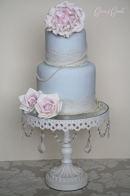 Victorian cake with blossoms pearls and lace. Do in white or champagne color.  Love the lace and pearl accent.  I would do with fresh blossoms.