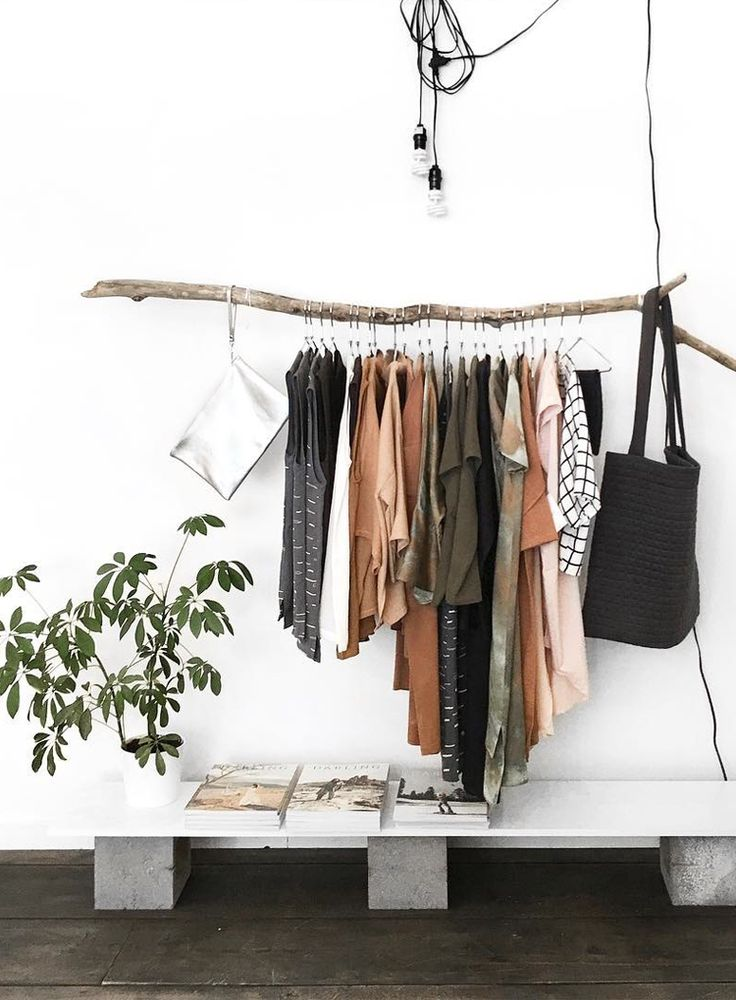 Earth-toned clothing rack.