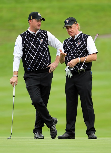 Miguel Angel Jimenez (R) talks with playing Partner Pater Hanson (L) during the rescheduled Afternoon Foursome Matches during the 2010 Ryder Cup at the Celtic Manor Resort on October 2, 2010 in Newport, Wales.