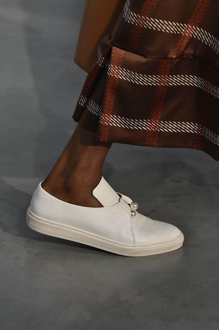 FLETCHER TRAINER IN WHITE our classic slip on trainer with signature pearl bar as seen on the catwalk. #motherofpearl #pearlyqueen #ss18 #sneakers
