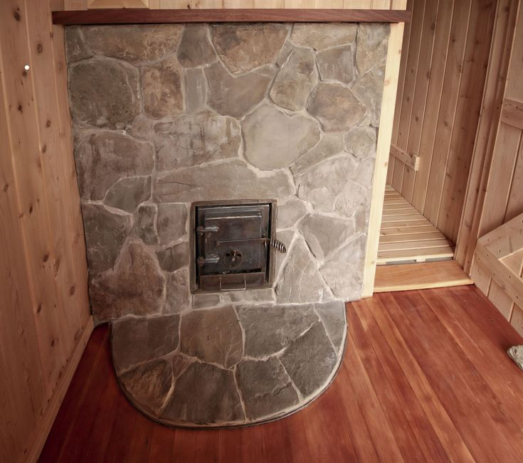 sauna stove fired from the dressing room by Rob Licht Custom Saunas