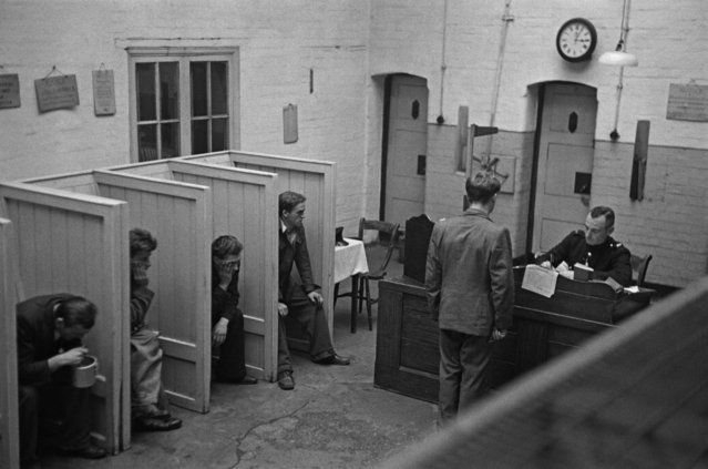 Prison officer Davidson interviewing a group of new prisoners in the reception room at Strangeways Prison, Manchester, UK on November 1948. (Photo by Bert Hardy/Picture Post/Hulton Archive/Getty Images)
