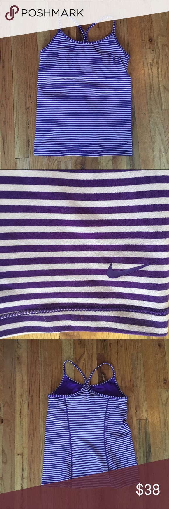 Nike Slim Fit Striped Racerback Athletic Tank Top Gently worn Nike DriFit racerback tank top with built in shelf bra! Great for yoga, pilates and barre.  Please refer to final picture for most accurate color representation. Alternating stripes of purple and lilac. Pads included in built in shelf bra.  Fit runs true, hem hits near or at hips depending on height. Similar style to lululemon's Power Y tank top. Please ask any questions! Nike Tops Tank Tops