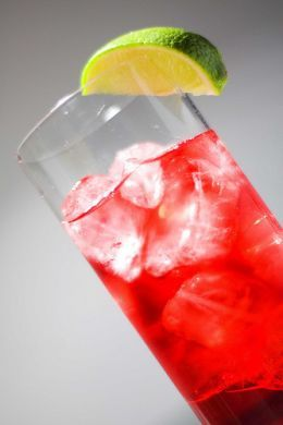 Woo Woo Cocktail Drink Ingredients  1 shot each: vodka and Peach schnapps  2 shots cranberry juice or orange juice    Fill highball glass with ice almost to top. Add the vodka and schnapps. Then add the shots of juice. Stir and serve.May garnish with a lime slice or wedge as shown.