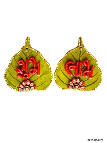 A very exclusive and best quality wooden wall decoration piece itself decorated with beautiful design on top completely made of paper mache in the sign of subh labh on pan patta shaped design. Decorate your walls and pooja ghar with this beautiful handmade artifact.   - See more at: http://indyhaat.com/Wall-Decor/Wall-Decor---Shubh-Labh-2-id-295490.html