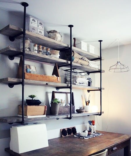 DIY Shelving Ideas: Plumbing parts and aged wood shelves combine to create a trendy industrial rustic shelf unit. You can find everything you need at your local home improvement store. Industrial Rustic Shelf Unit Tutorial