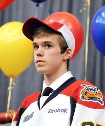 Connor McDavid, beast mode at 16. I love how he is really intense and in the background there is just a bunch of balloons